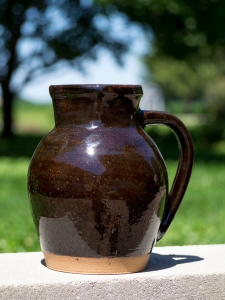 Brown glazed rounded ceramic pitcher