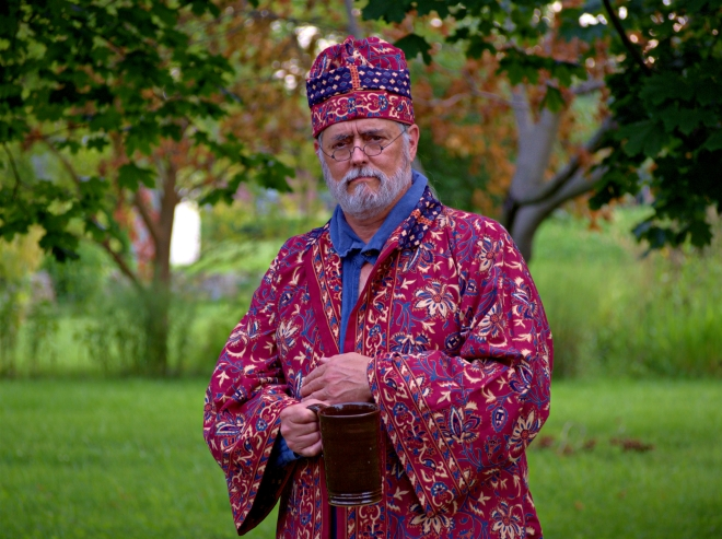 A long red overrobe with matching cap